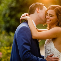 David Mendoza III Photography captures a bride and groom embracing during their wedding at Morning Glory Farms