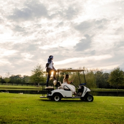 David Mendoza III Photography captures a moment of fun at Morning Glory Farms as a bride and groom take a quick ride in a golfcart