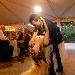 Groom dips his new bride during their first dance at their Morning Glory Farms Wedding reception