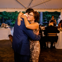 Groom dances with his mother to music by Carolina DJ Professionals during his wedding reception coordinated by Magnificent Moments Weddings