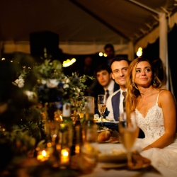 David Mendoza III Photography captures a bride and groom enjoying the toasts of family and friends during their fall wedding at Morning Glory Farms in Monroe North Carolina