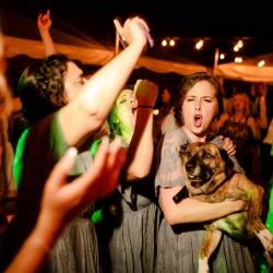 David Mendoza III Photography captures a bridesmaids enjoying a wedding reception at Morning Glory Farms coordinated by Magnificent Moments Weddings