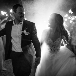 Bride and groom share a smile at their end of the magical wedding at Morning Glory Farms coordinated by Magnificent Moments Weddings