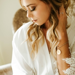 Bride shows of her stunning hair and makeup done by Jennifer Abercrombie Beauty and captured by David Mendoza III Photography