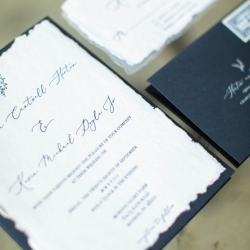 Detail shot of stunning invitation suite that features navy details and delicate calligraphy all captured by David Mendoza III Photography