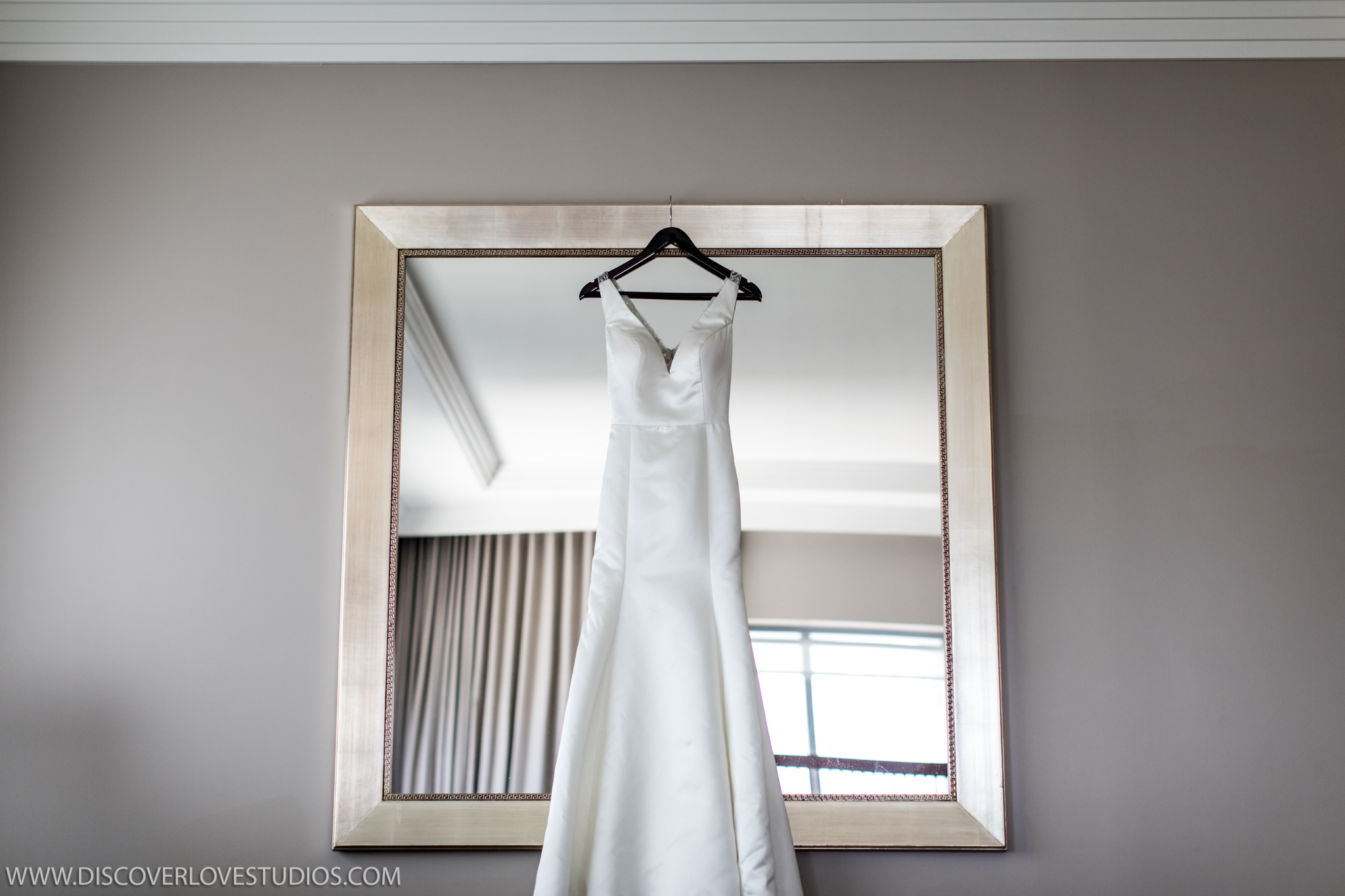 Discover Love Studios captures detail shot of bridal gown before wedding ceremony at The Mint Museum Uptown