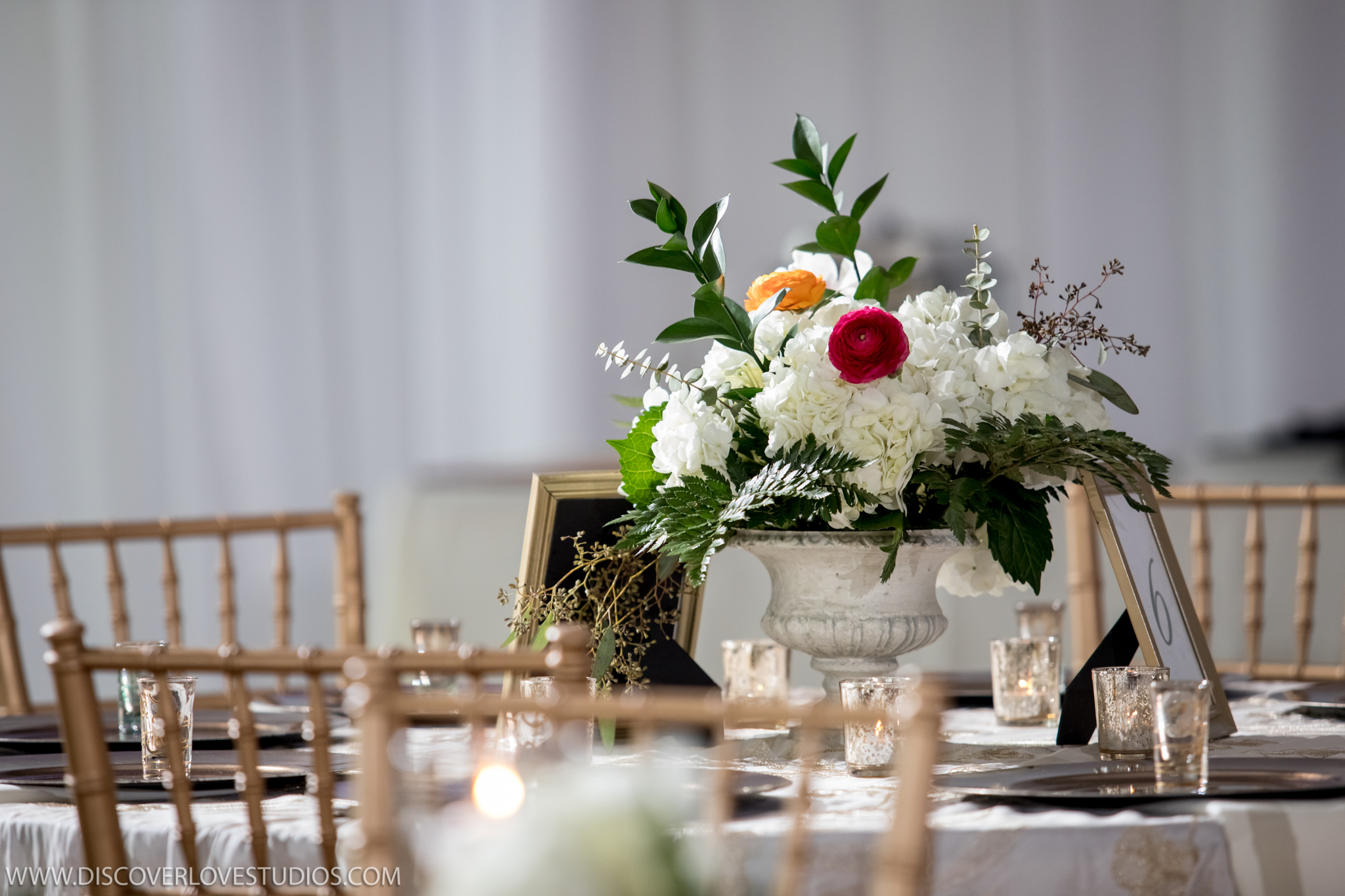 Discover Love Studios captures centerpieces made by Magnificent Moments Weddings for a wedding reception at The Mint Museum Uptown