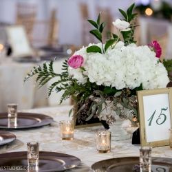 White hydrangeas accented by pink roses create stunning centerpieces by Magnificent Moments Weddings for a Uptown Charlotte wedding