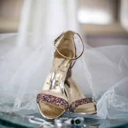 Detail shot of bridal accessories before a wedding ceremony at The Mint Museum Uptown