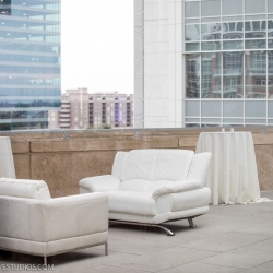 Outdoor patio at the Mint Museum Uptown serves as relaxing bar area for a Charlotte wedding coordinated by Magnificent Moments Weddings