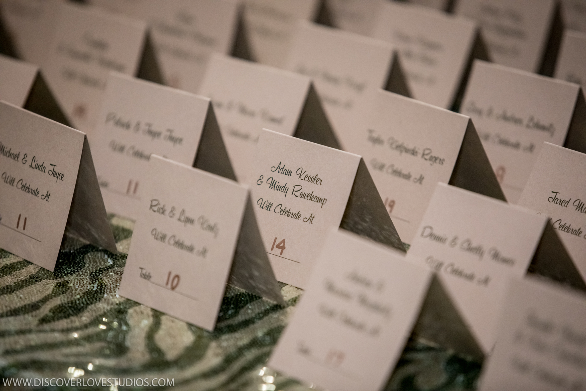 Discover Love Studios captures escort cards for Mint Museum Uptown Charlotte wedding coordinated by Magnificent Moments Weddings