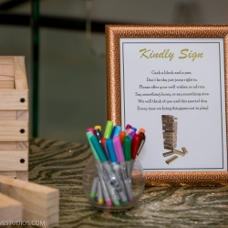 Unique guestbook Jenga game shows off a fun couples style for a Uptown Charlotte wedding coordinated by Magnificent Moments Weddings