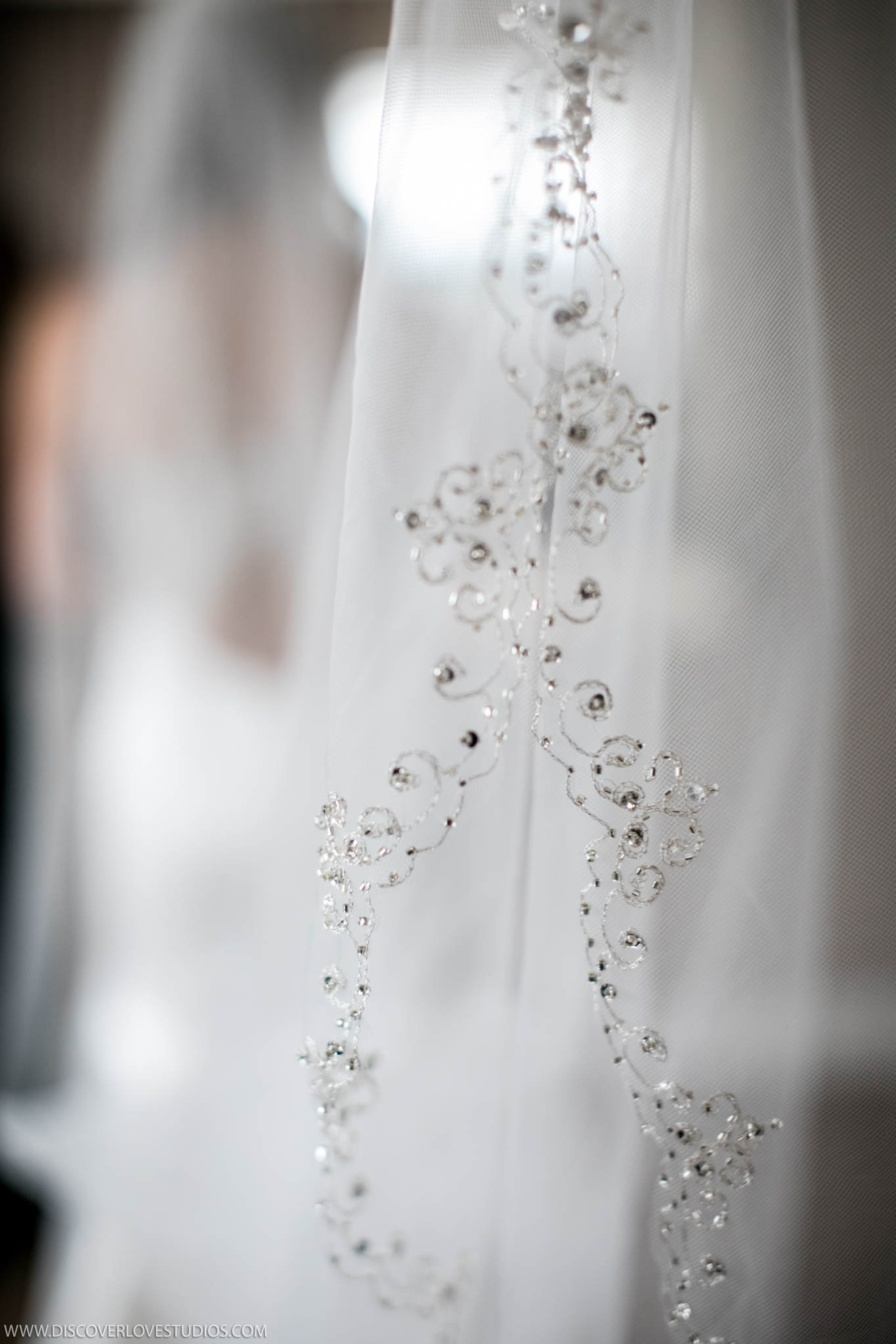 Discover Love Studios captures detail shot of bridal veil before wedding at the Mint Museum Uptown