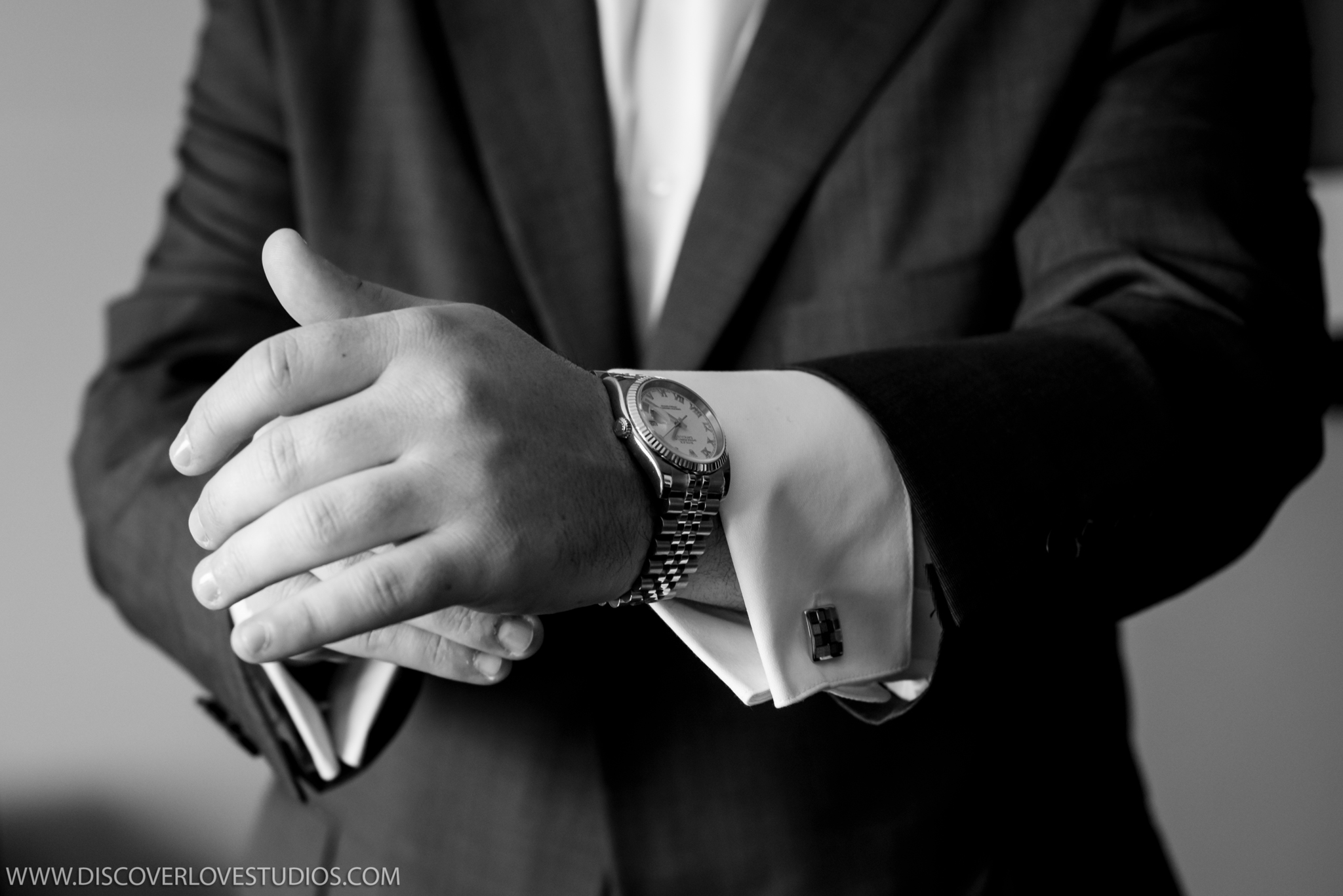 Detail shot of groom's watch captured by Discover Love Studios