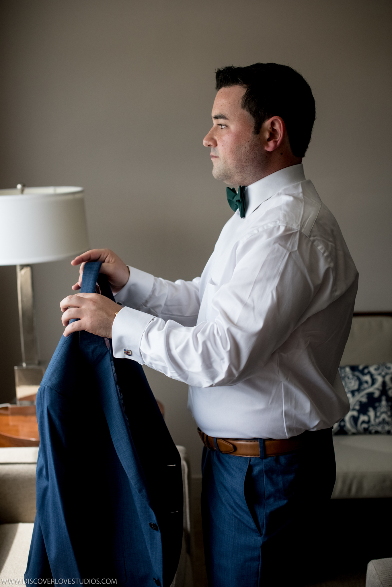 Groom dresses before his uptown Charlotte Wedding