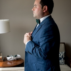 Discover Love Studios captured groom dressing for his wedding at the Mint Museum Uptown coordinated by Magnificent Moments Weddings
