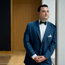 Groom preparing for wedding at The Mint Museum Upton captured by Discover Love Studios