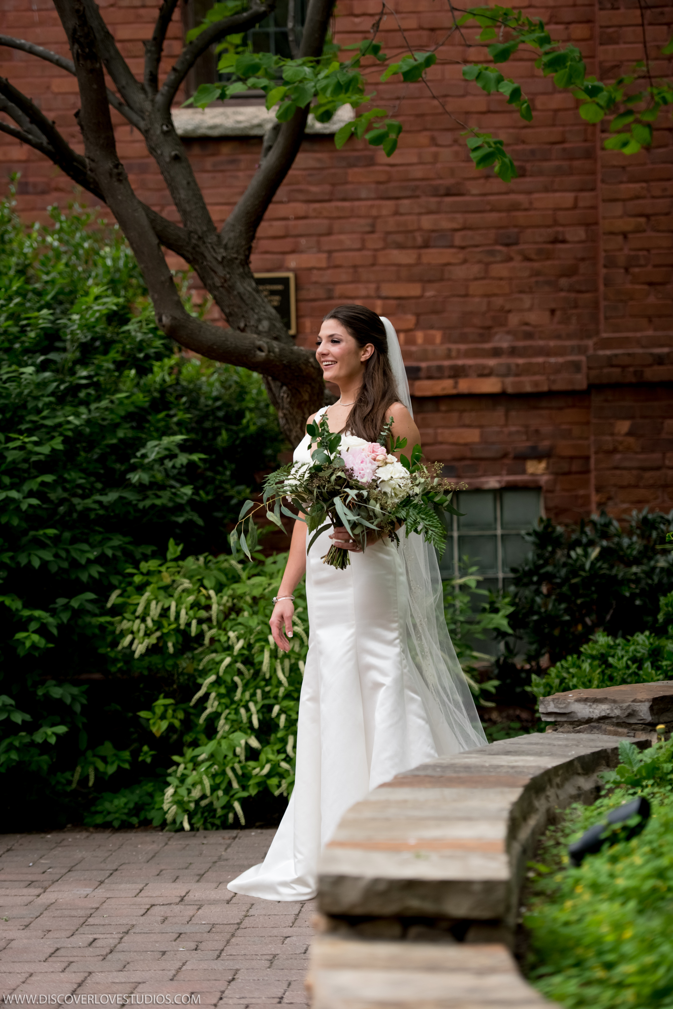 Bride enters into The Green in Uptown Charlotte for first look with groom before their wedding at The Mint Museum Uptown