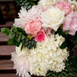 Stunning bridal bouquet features white hydrangeas, blush pink flowers, and green accents for a wedding at The Mint Museum Uptown