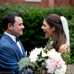 Bride's reaction to first look of her groom before her uptown Charlotte wedding