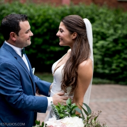 Bride and groom pose for Discover Love Studios before their uptown Charlotte wedding