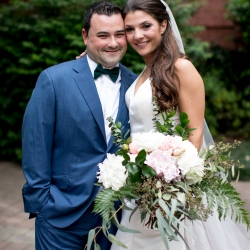 Bride ad groom pose before their uptown wedding coordinated by Magnificent Moments Weddings