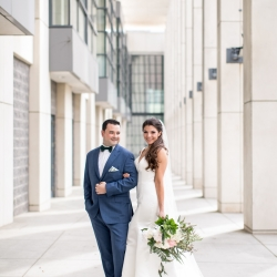 Bride and groom captured by Discovery Love Studios before their wedding at The Mint Museum Uptown wedding