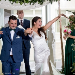 Bride and groom leave their wedding ceremony coordinated by Magnificent Moments Weddings