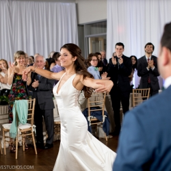 Bride and groom dancing at their uptown wedding coordinated by Magnificent Moments Weddings