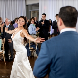 Bride and groom dance to music provided by Split Second Sound at their Mint Museum Uptown wedding