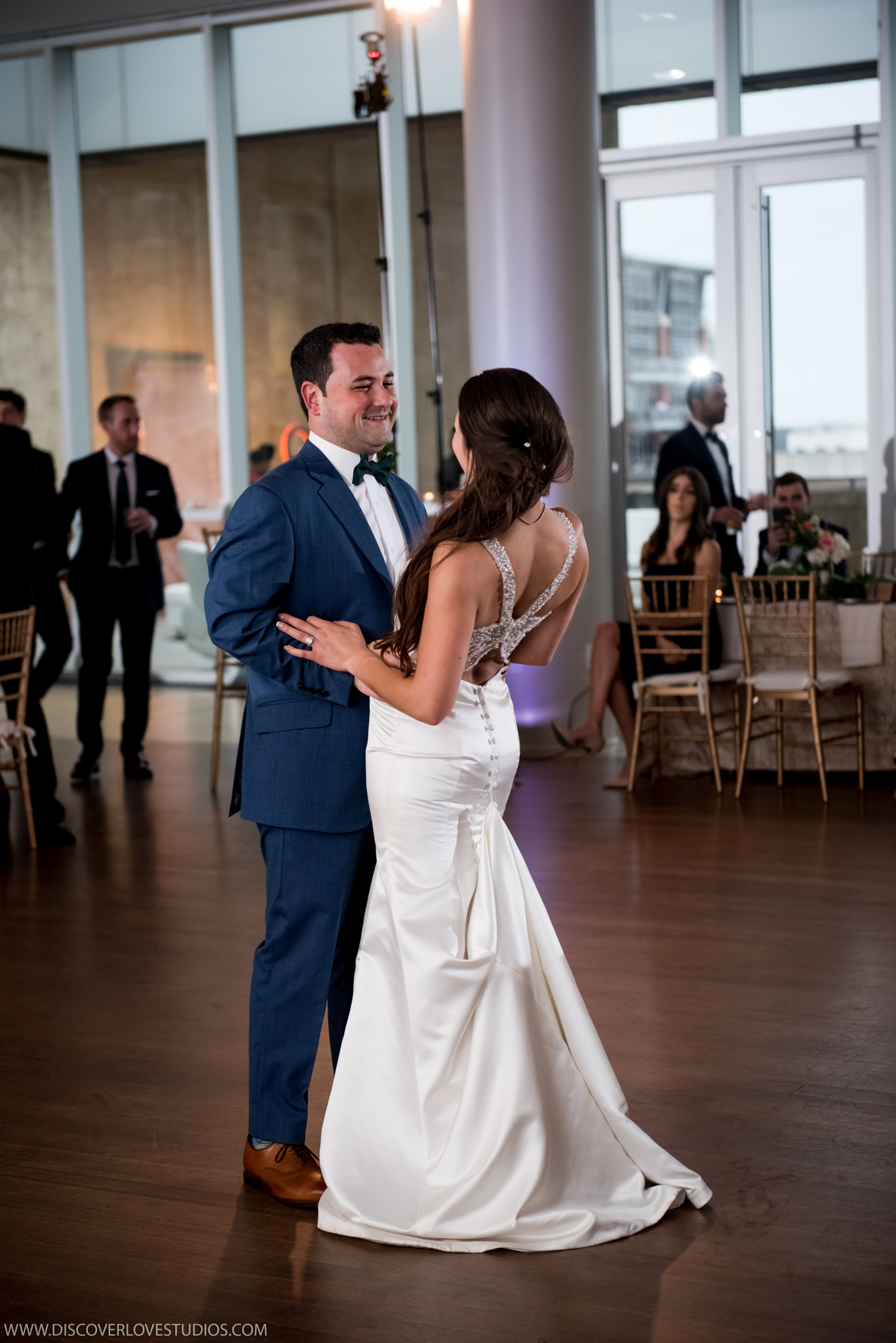 Bride and groom dance during their Mint Museum Uptown reception captured by Discover Love Studios