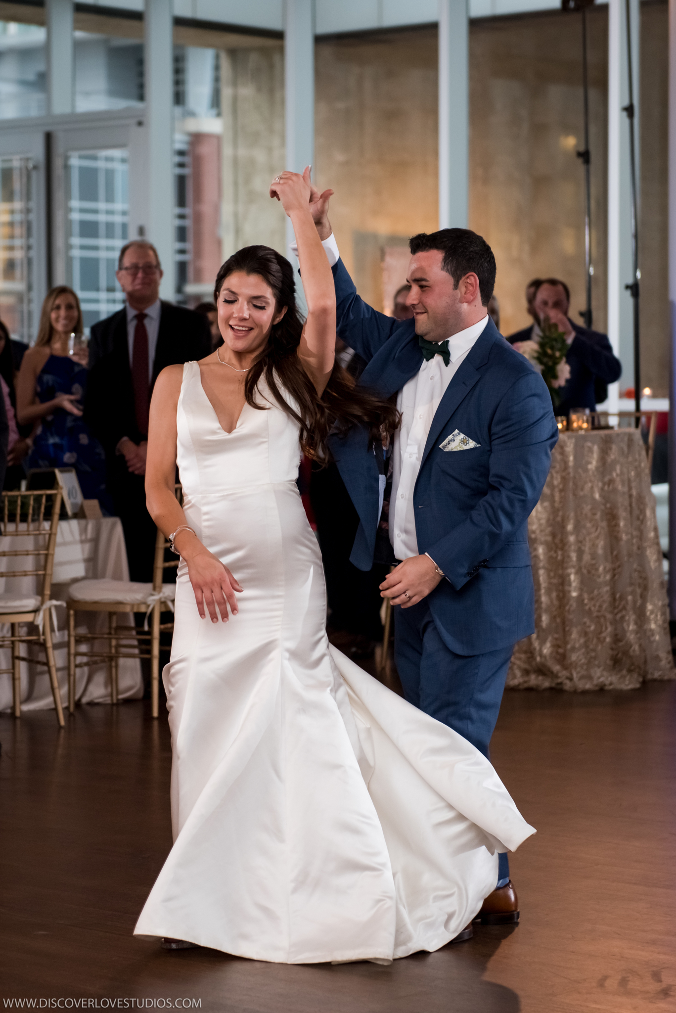Bride spins groom at uptown wedding reception coordinated by Magnificent Moments Weddings