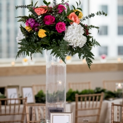 Tall center pieces created by Magnificent Moments Weddings for a wedding reception at The Mint Museum Uptown
