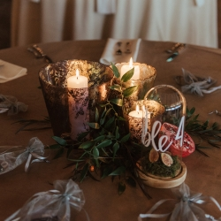 Candles and greenery create a romantic look for a fall wedding at Savona Mills captured by Elli McGuire Photography