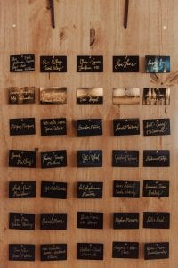 Unique table seating chart featured metal place cards for an industrial feel for a fall wedding at Savona Mills