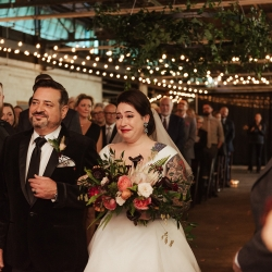 Bride walks down the aisle with her father during her fall wedding at Savona Mills in Charlotte, North Carolina