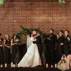 Bride and groom kiss after exchanging vows during their fall wedding captured by Elli McGuire Photography