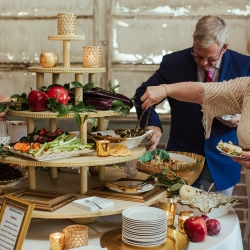 Delectables by Holly created a stunning tiered appetizer station for a fall wedding at Savona Mills