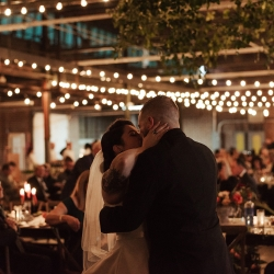 Bride and groom share a kiss during their first dance coordinated by Magnificent Moments Weddings