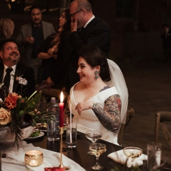 Bride smiles with her dad during her fall wedding captured by Elli McGuire Photography