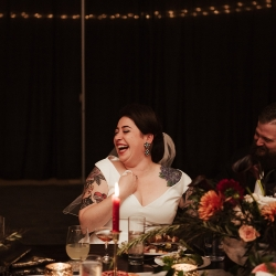 Bride and groom laugh with guests during their fall wedding captured by Elli McGuire Photography