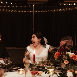 Bride share a fun moment with guests during her fall wedding at Savona Mills in Charlotte, North Carolina
