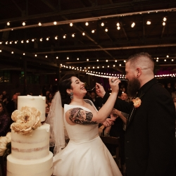Bride and groom share cake from Suarez bakery during their fall wedding captured by Elli McGuire Photography