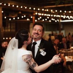 Bride shares a sweet dance with her father under stunning Edison lights installed by Cooke Rentals