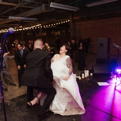 A fall reception at Savona Mills in Charlotte, North Carolina featured a fun garter toss coordinated by Magnificent Moments Weddings