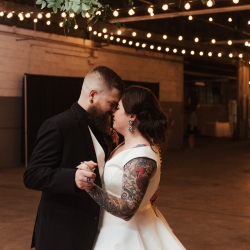 Bride and groom share a private last dance following their fall industrial wedding at Savona Mills in Charlotte, North Carolina
