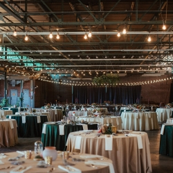 Savona Mills served as the industrial backdrop for a fall wedding featuring Edison lights and velvet linens from Cooke Rentals
