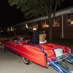 Elli McGuire captures a bride and groom leaving their Savona Mills wedding in Charlotte in the back of a red vintage Cadillac