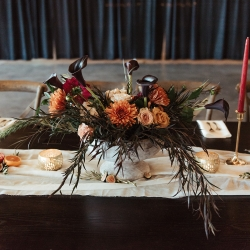 Floral centerpiece features unique blooms and lush greenery designed by Narcisse Greenway Design for a fall wedding in Charlotte