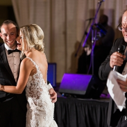 Bride and groom smile as her father shares a touching speech all captured by Erin Kranz Photography